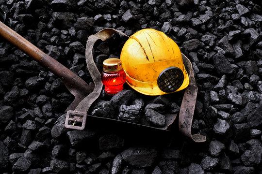 Vigil light, candle with the miner belongings (helmet, shovel, belt)