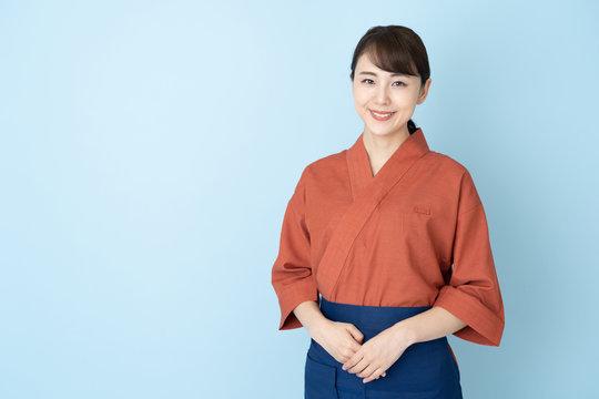 portrait of japanese style waitress isolated on blue background