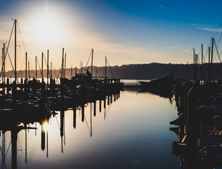 Morning sunrise harbor with hazy filtered light and shadows