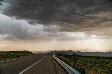 Roadway and stormy clouds