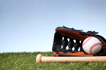 Baseball equipment on green grass