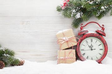 Christmas gift boxes, alarm clock and fir tree