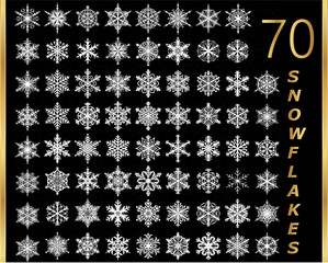 Collection of golden snowflakes on a black background