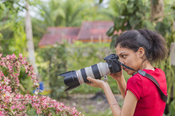Woman photographer with dslr camera