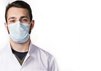 young doctor in mask on white background
