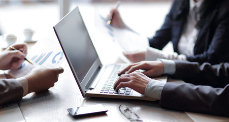 close up. businessman and business team analyze financial data