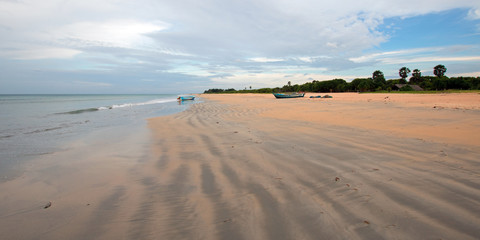 Beached boat on Nilaveli beach in Trincomalee Sri Lanka Asia
