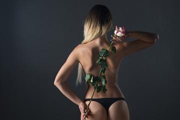Beautiful naked woman on a black