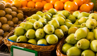 appetizing pears on counter in market