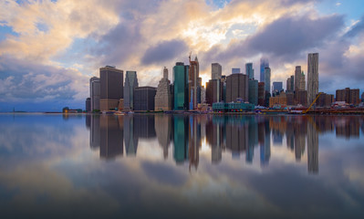 New York City Skyline Reflections at sunrise over Hudson River.