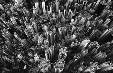 Black and white of aerial view of Hong Kong Downtown. Financial district and business centers in smart city in Asia. Top view of skyscraper and high-rise buildings.
