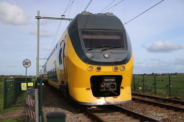 Intercity train at railroad track between Gouda and Rotterdam at Moordrecht.