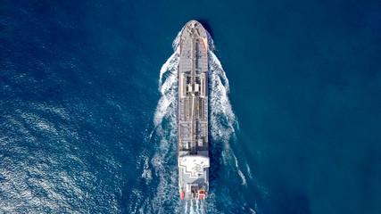 Large crude oil tanker roaring across The Mediterranean sea - Aerial image