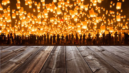 Wooden foreground with Yipeng Lantern festival background in Chiangmai, Thailand.