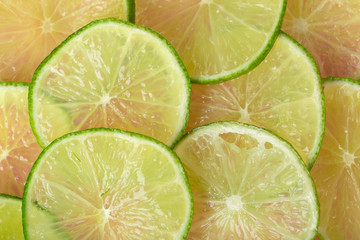 Juicy lime slices flat lay
