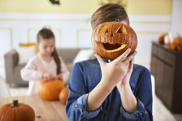 Boy with scary Halloween pumpkin