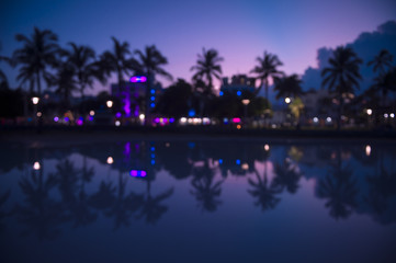 Abstract south Beach Miami Florida sunset skyline over Ocean Drive reflecting in a puddle