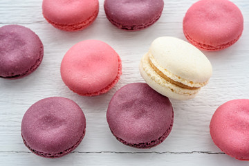 Sweet macarons on a white  background. Trendy cakes.