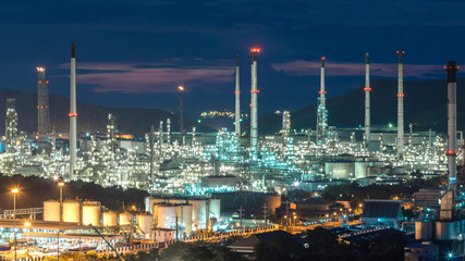 Beautiful sunset  petrochemical oil refinery factory plant cityscape of Chonburi province at night on 2017 , landscape Thailand