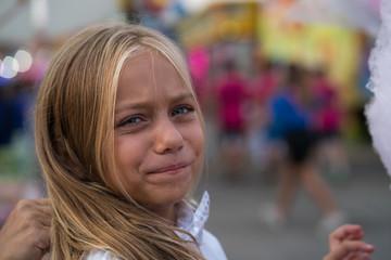Pretty blue eyes girl at the fair