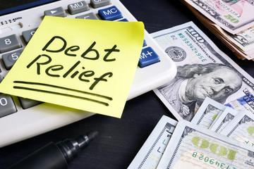 Debt relief handwritten on a note pad.