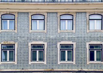Lisbon windows with typical portuguese tiles on the wall