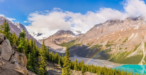Wall Mural - Panoramic view at the Peyto lake ,Peyto peek with rainbow from Bow Summit in Banff National Park - Canadian Rocky Mountains