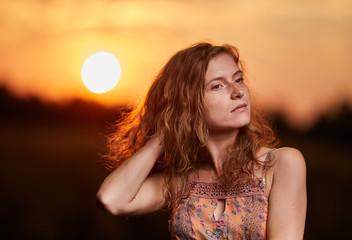 Fototapeta Golden hour portrait of a beautiful woman