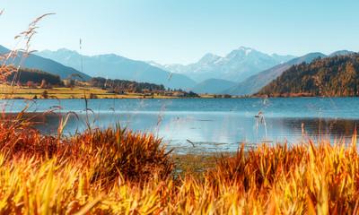 Wonderful Alpine Highlands with magic lake in Sunny Day.