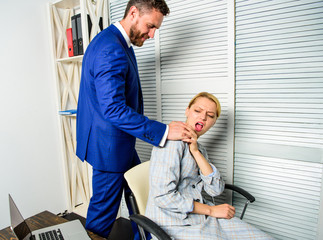 Behavior rule and subordinate at work. Boss unacceptable behavior with subordinate employee. Boss touch shoulder of female office colleague. Tired woman worker relaxing while man massaging her