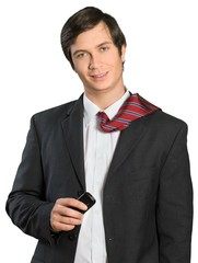 Businessman with tie over shoulder holding cell phone