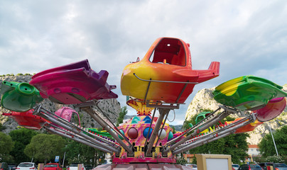 Colorful carousel in the amusement park.