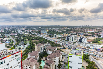 High view point cityscape of Accra, Ghana. Traffic jam on George Bush Highway with hills on the background Wall mural