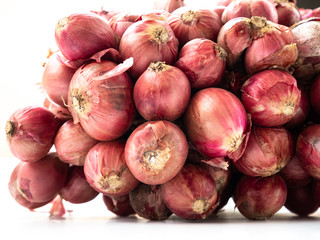 Shallots after harvest are placed on a white background