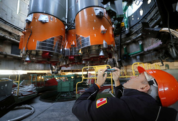 Backup crew member CSA astronaut David Saint Jacques looks at the Soyuz booster rocket with the Soyuz MS-10 spacecraft installed on the launch pad at the Baikonur Cosmodrome