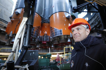 Backup crew member CSA astronaut Saint Jacques looks at the Soyuz booster rocket with the Soyuz MS-10 spacecraft installed on the launch pad at the Baikonur Cosmodrome