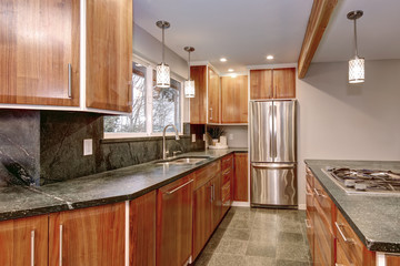Luxurious kitchen room with stainless steel appliances.