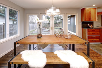 Spacious dining room with wooden dining table