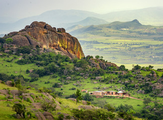 Ezulwini valley in Swaziland with beautiful mountains, trees and rocks in scenic green valley between Mbabane and Manzini cities. Traditional huts houses of Swaziland Wall mural