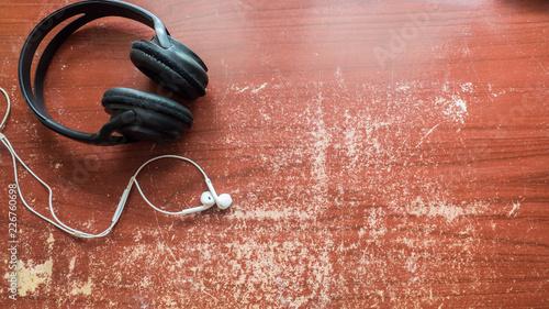 Wall mural headphones and earphone on wood table