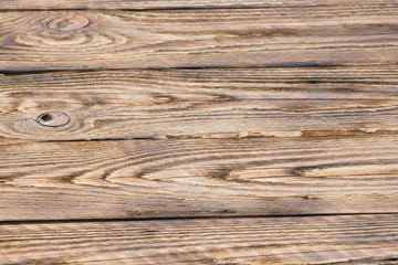 Soft focus photo of old partly burned wooden background