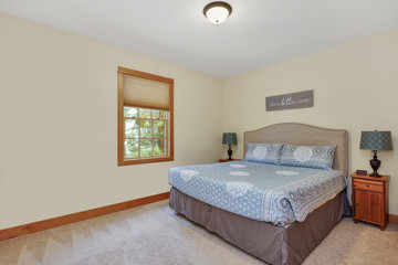 Nice guest room interior with light yellow walls