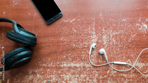 Wall mural earphone and smart phone on wood table