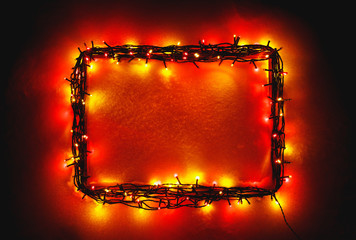 Christmas lights frame on snow background, red color