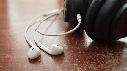 Wall Mural - white earphone and headphone on wood table