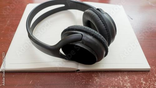 Wall mural earphone on notebook