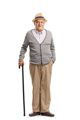 Senior man standing with a cane