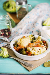 baked cauliflower and broccoli with cheese on a plate