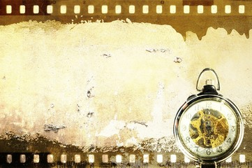 Grunge sepia film strip frame with pocket watch. Copy space.