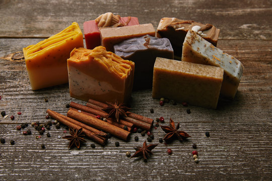 close-up shot of homemade soap pieces with spices on rustic wooden tabletop